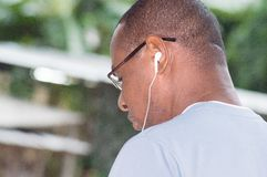 Closeup of the head of a young man with a headset Stock Photo