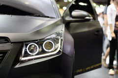 Closeup headlight of black car background Royalty Free Stock Photo