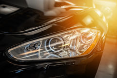 Closeup on an headlight of a black sport car Royalty Free Stock Image