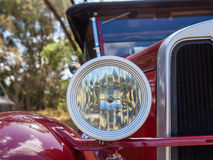 Closeup of the headlight and grill of a vintage car Royalty Free Stock Images