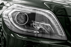 Closeup headlights of business car. Royalty Free Stock Image