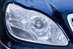 Closeup of the headlights of a car Stock Photography