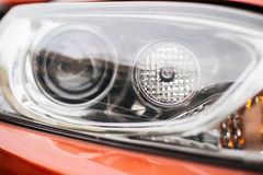 Closeup headlights of car. Background Stock Images
