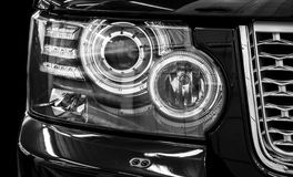 Closeup headlights of car. Royalty Free Stock Photos