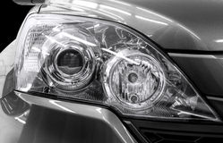 Closeup headlights of car. Royalty Free Stock Images