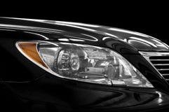 Closeup headlights of car. Car exterior detail stock photography