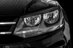 Closeup headlights of car. Car exterior detail royalty free stock images