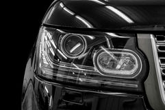 Closeup headlights of car. Royalty Free Stock Image