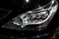 Closeup headlights of car.modern light element Royalty Free Stock Image