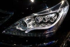 Closeup headlights of car.modern light element Royalty Free Stock Image