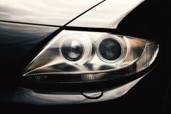 Closeup headlights of car. Closeup headlights of new car Stock Photo
