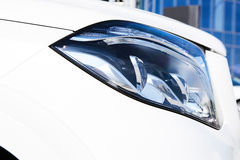 Closeup headlights of luxury car. Royalty Free Stock Photography