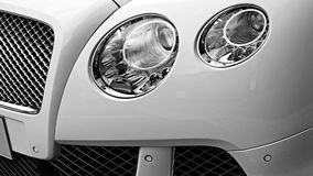 Closeup headlights of luxury car. Stock Photography