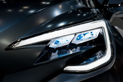 Closeup headlights of modern car Stock Photos