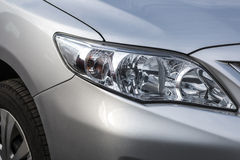 Closeup headlights . Modern car. Concept of expensive auto stock photos