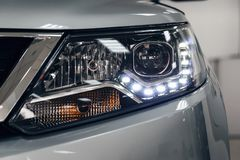Closeup headlights of a modern car. Detail on the front light of a car stock image