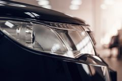 Closeup headlights of a modern car. Detail on the front light of a car royalty free stock images
