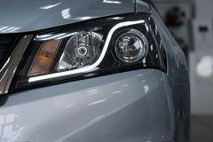 Closeup headlights of a modern car. Detail on the front light of a car royalty free stock image