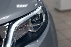 Closeup headlights of a modern car royalty free stock images