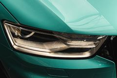 Closeup headlights of a modern Mint color car stock photo