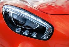 Closeup headlights of modern sport yellow car. Car exterior deta Stock Photography