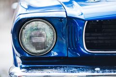 Closeup headlights of retro muscle car. Car exterior detail.  Royalty Free Stock Photo