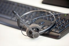Closeup Of Headphone On Keyboard Royalty Free Stock Images