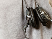 Closeup of headphones hanging upside down Royalty Free Stock Photo