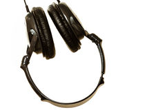 Closeup of headphones hanging upside down Royalty Free Stock Photos