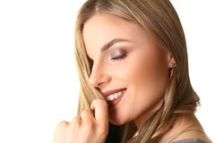 Closeup Headshot of Caucasian Female Beauty Model. Young Blond Trendy Woman with Natural Makeup and Red Lipstick Touching her Lips. Dreamy Girl Side View stock photo