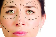 Closeup headshot caucasian woman with dotted lines drawn around face looking into camera, preparing cosmetic surgery Stock Image