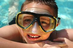 Closeup headshot of a kid in a. Diving mask having summer fun in the cool, clear water Stock Image