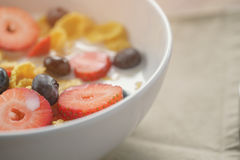 Closeup of healthy breakfast with corn flakes and berries in white bowl. Slightly toned photo Royalty Free Stock Images