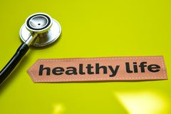 Closeup healthy life with stethoscope concept inspiration on yellow background stock image