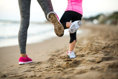 Closeup on healthy mother and baby girl workout Stock Photos