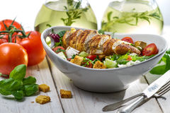 Closeup of healthy salad with chicken, tomato and olive royalty free stock image