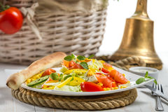 Closeup of healthy salad with salmon and fresh vegetables Royalty Free Stock Image
