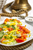 Closeup of healthy salad with salmon and vegetables Royalty Free Stock Photography