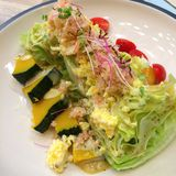 Closeup healthy salad  top with white crab and egg. Closeup healthy salad - lettuce pumpkin and tomato - on top with white crab and egg Stock Photo