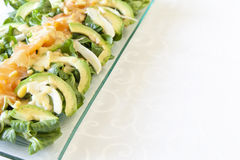 Closeup of healthy salmon salad with avocado and organic vegetables with mustard sauce, selective focus Stock Photo
