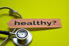 Closeup prevetion cure with stethoscope concept inspiration on yellow backgroundCloseup Healthy with stethoscope concept inspirati. Closeup Healthy with royalty free stock photo