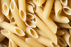Closeup of the heap of uncooked pasta Stock Photos