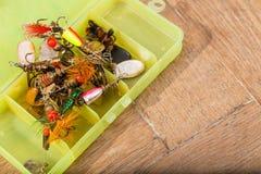 Closeup heaps of fishing bait lures in box Stock Photo