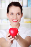 Closeup on heart in pharmacist`s hands. Stock Images