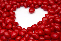 Red hot candies heart shape. Closeup of heart shape made out of red hot candies Royalty Free Stock Photography