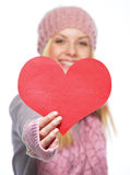 Closeup on heart shaped postcard in hand of teenager girl Stock Images
