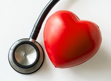 Closeup of heart and a stethoscope cardiovascular checkup concept Royalty Free Stock Photo