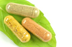 Closeup of herbal capsules on mint leaf Stock Photo