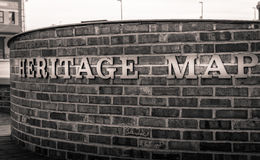 Closeup of heritage map words on a brick wall background. Black and white Stock Images