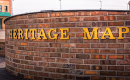 Closeup of heritage map words on a brick wall. Background. In color Stock Photo